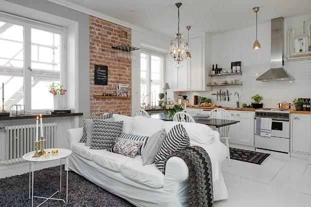 Open space cuisine et séjour stile moderne avec mur en brique.